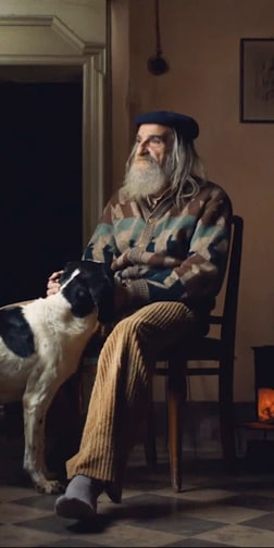 An older man and a dog sitting together, from The Truffle Hunters