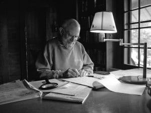 Oliver Sacks writing at a desk