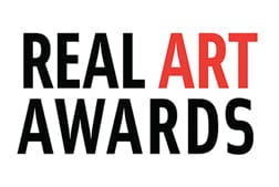 "A white background with text. In black and red letters it states"" Real Art Awards""."