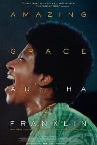 "Side profile of Aretha Franklin singing. Yellow text ""Amazing Grace"". White text ""Aretha Franklin""."