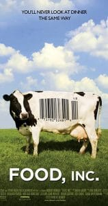 "Cow standing in a grassy field. There is a bar code on the cow's side. White letters in the green grass ""Food Inc.""."