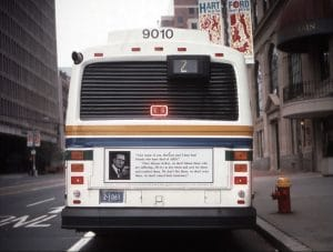 "Bus driving through Hartford. On the bus is the Group Material ""AIDS Bus Poster""."