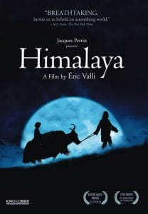 "Silhouette of a man and cow walking in front of a rising moon. White text ""Himalaya""."