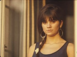 Young Linda Ronstadt, with her hair in a side braid.