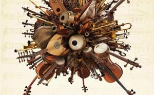 Violins, cello's, and other string instruments arranged in a cluster.