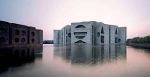 Geometric building surrounded by water.