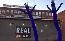 Two purple Wacky Wavy Guys outside of Real Art Ways building.