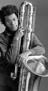 Anthony Braxton holding a baritone saxophone.