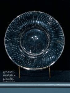 A round glass plate decorated with lines