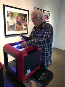 Ian's father, Paul, working on a 3D printer.