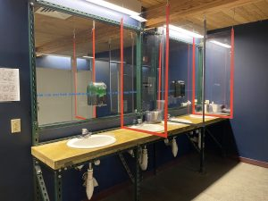 Plexiglass partitions at bathroom sink