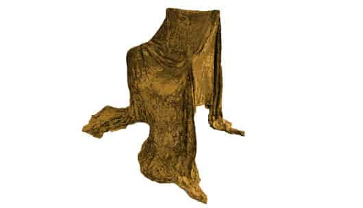 A chair draped in gold fabric