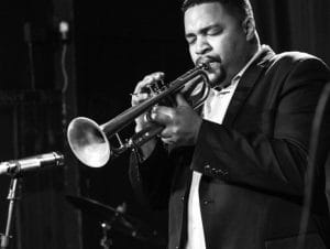 Haneef Nelson playing the trumpet