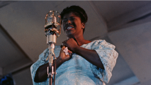 A woman singing at a microphone