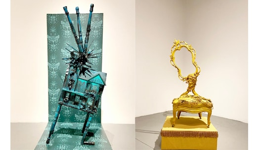 A leaning spiky blue dollhouse and golden chair next to each other