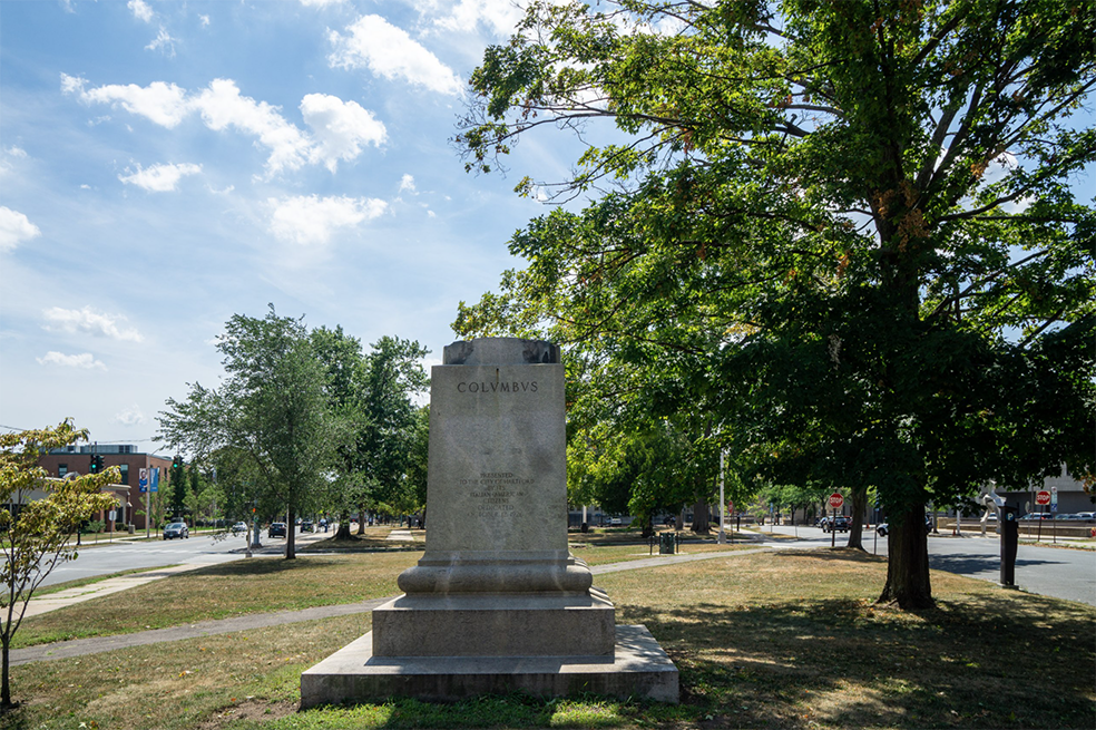 A pedestal that once held a statue of Christopher Columbus in Hartford now sits vacant within a park.