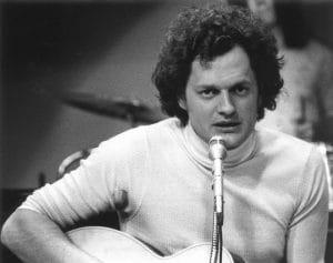 Harry Chapin playing guitar