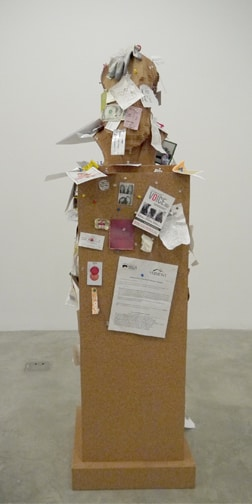 Paul Ramirez Jonas sculpture, cork monument bust, with papers affixed by pushpins from gallery visitors