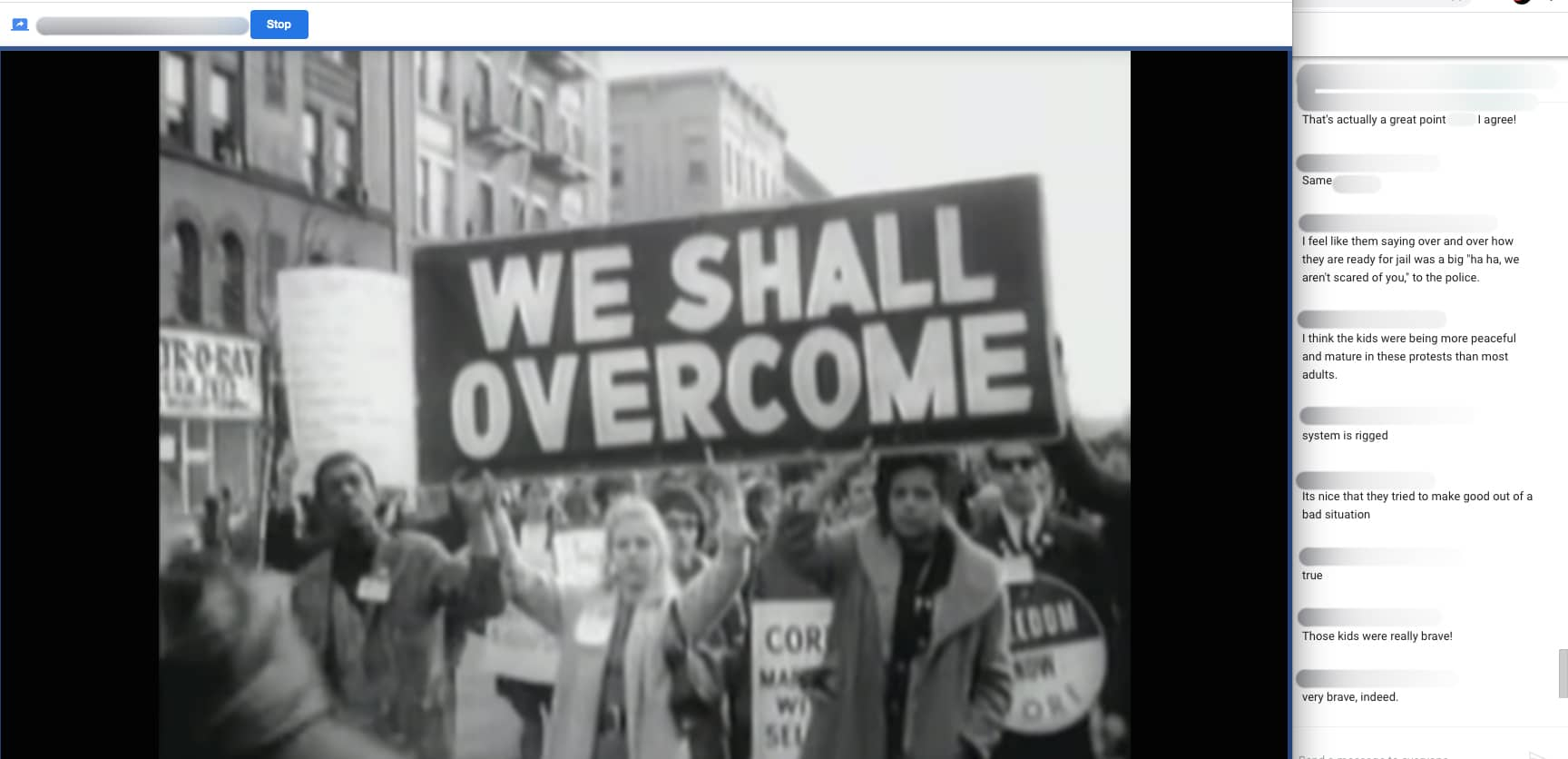 Screenshot of a Virtual Film Field Trip. A film with civil rights protesters marching is on the computer screen and to the side is a chat thread