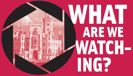 "A pink square with a cameras aperture open with a castle inside it. Next to the aperture is the text ""What Are We Watching?"""