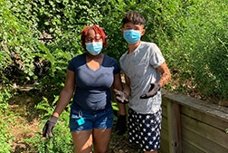 Two Real Apprentices gardening with masks on