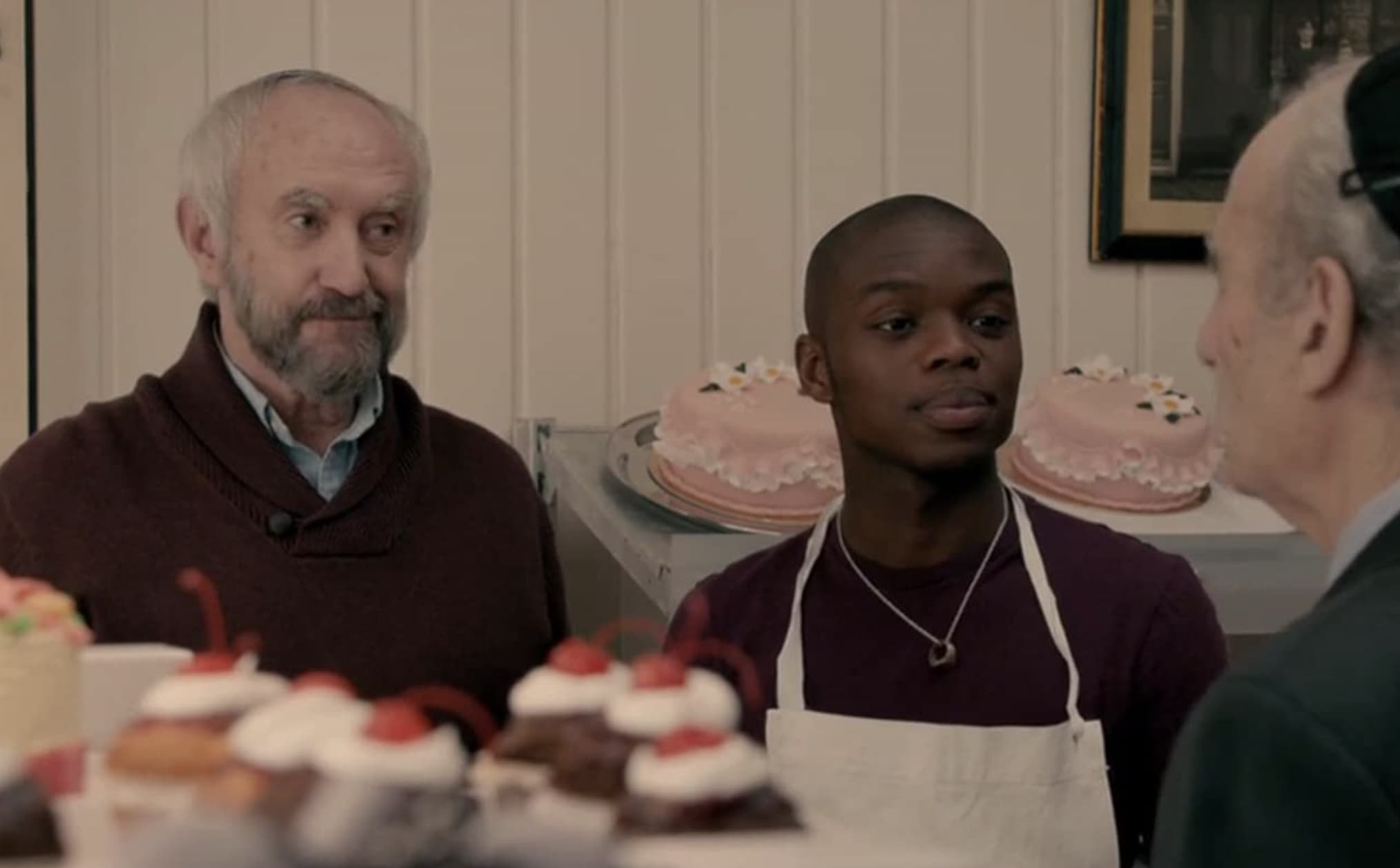Two men in a bakery from the movie Dough