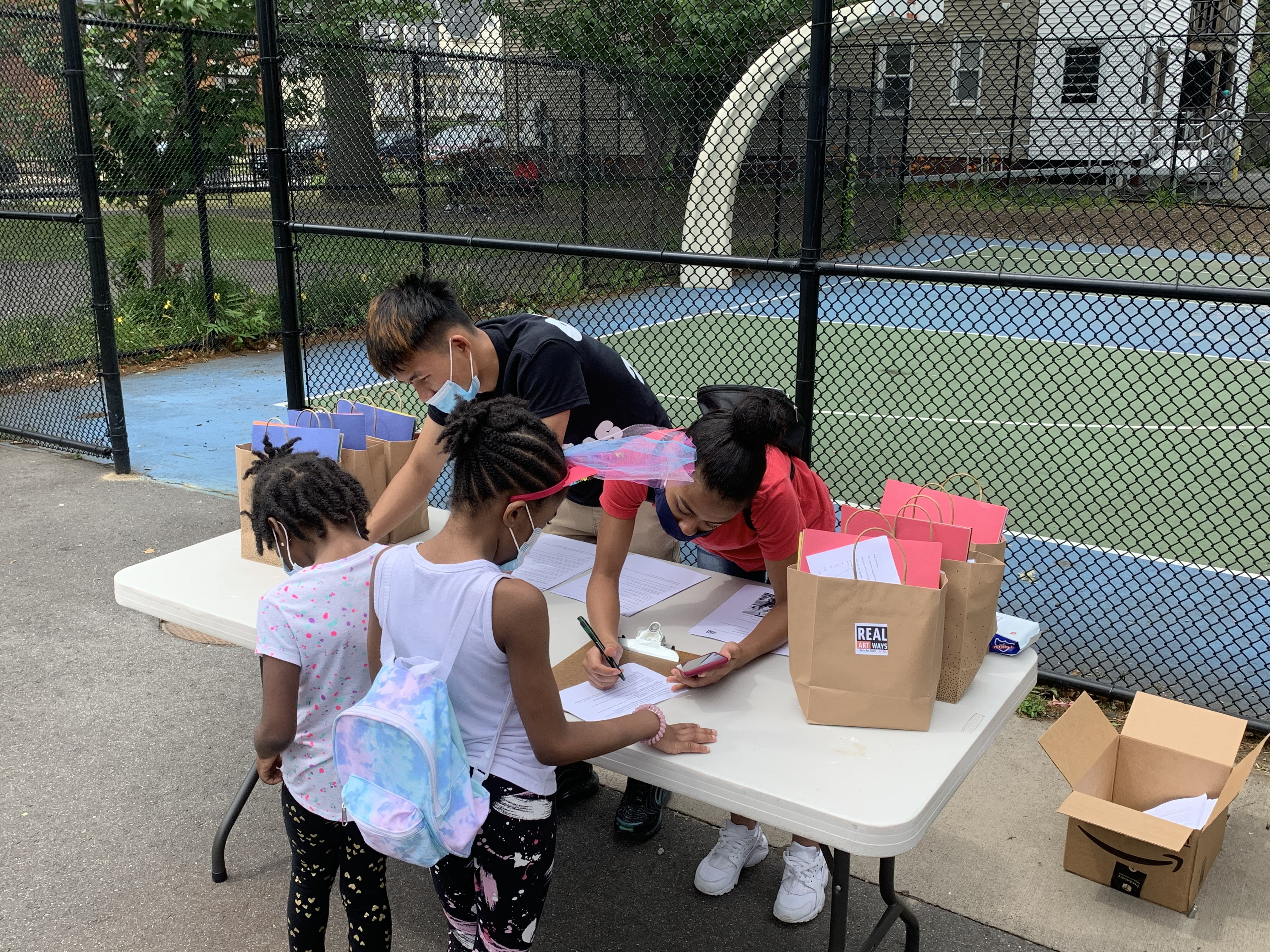 Park Art take home art kits being distributed in George Day park.