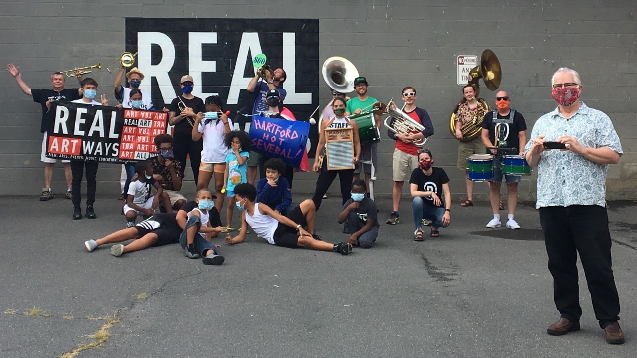 Real Art Ways staff, local children, and local band Hartford Hot Several after a Parade through Parkville commemorating 30 years of Park Art.