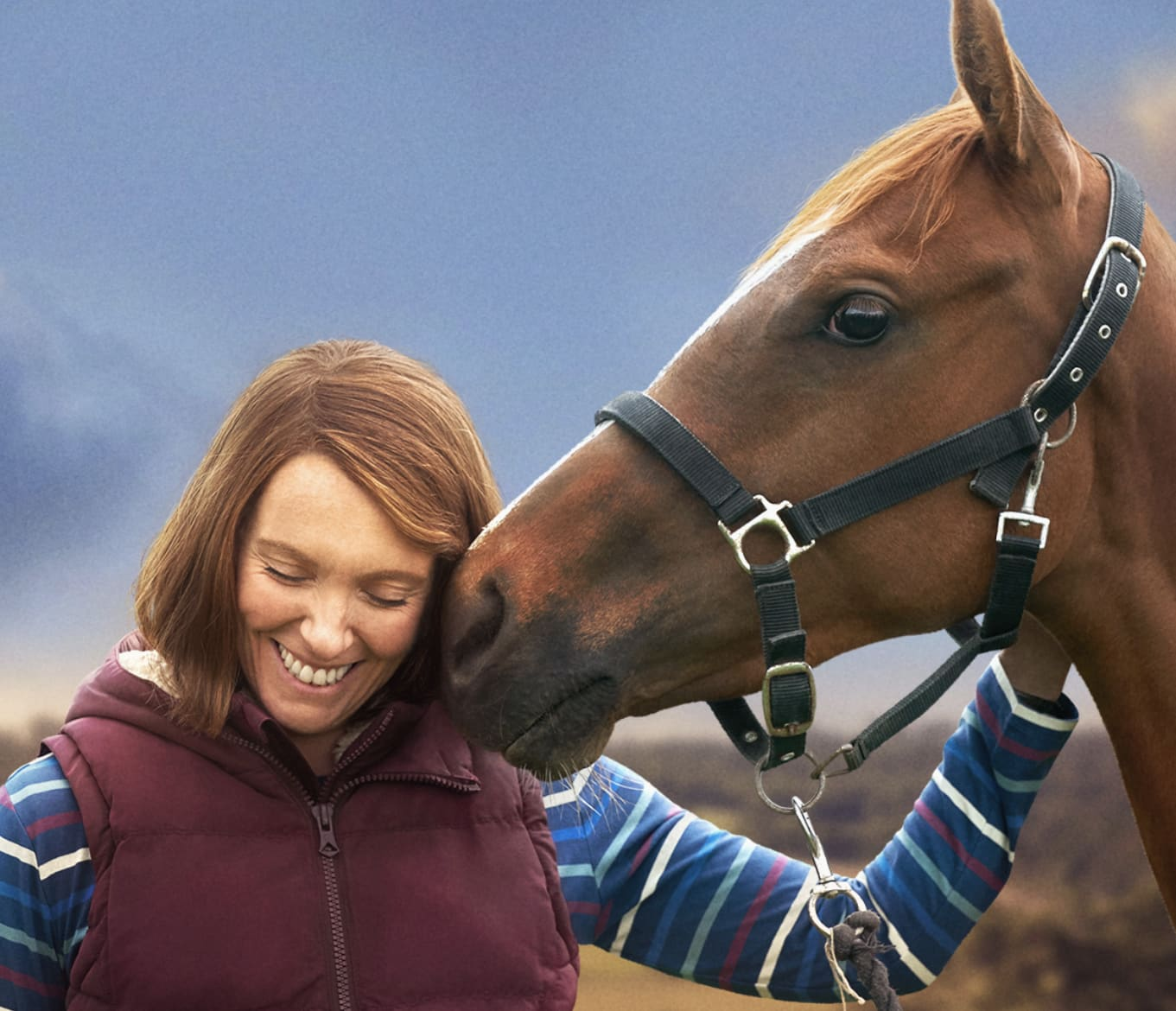 Toni Colette being nuzzled by a horse, from Dream Horse